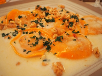 tortelli alla zucca al taleggio 11 pumpkin ravioli served with taleggio cheese cream and walnuts