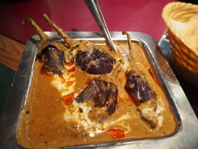 Baby aubergine in peanut sauce